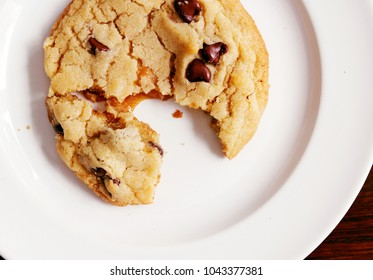 Chocolate Chip Cookie with Caramel Filling on a White Plate