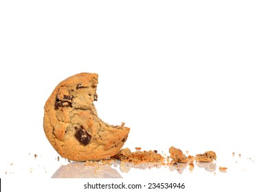 chocolate chip cookie and crumbs isolated white background