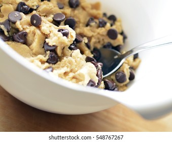 Chocolate Chip Cookie Dough in mixing bowl with spoon
