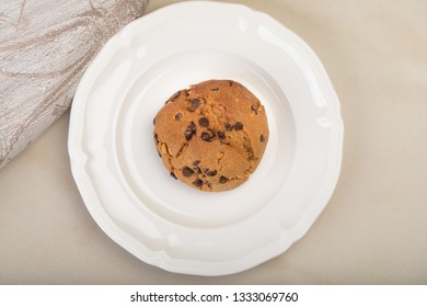 Chocolate chip cookie on white porcelain plate