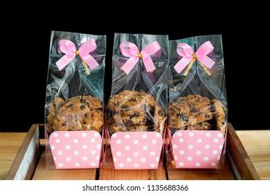 Chocolate chip cookie in plastic bag packaging.