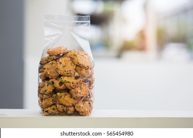chocolate chip cookie in plastic bag with copy space.