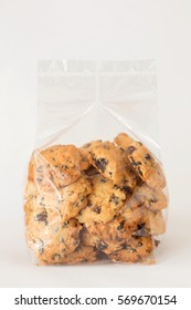 Chocolate chip cookie in plastic bag isolated on white background.