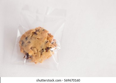 Chocolate chip cookie in plastic bag isolated on white background.copy space.
