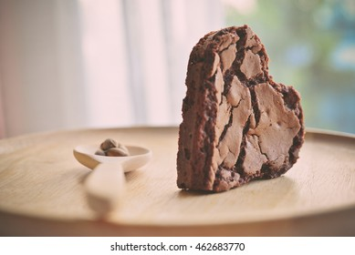 Chocolate chip cookie in the shape of heart, with wooden spoon. Concept about love and relationship.(Vintage Style)