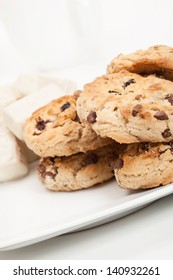 Chocolate chip cookies and chocolate candy on plate