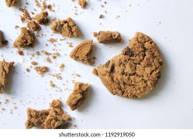 Chocolate chip cookies with crumbs isolated on white background