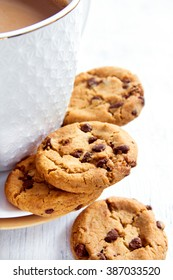 Chocolate chip cookies and cup of hot chocolate on wooden table