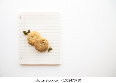 Chocolate Chip Cookies and Marijuana Buds on a Binder Paper Plate