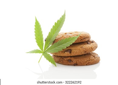 Chocolate chip cookies with marijuana leaf isolated on white background. Space cookies.