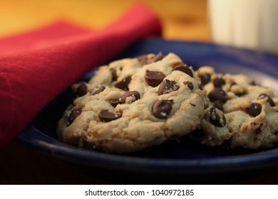 Chocolate chip cookies and milk close up