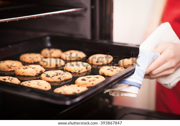 chocolate chip cookies on baking pan hot out of the oven close up
