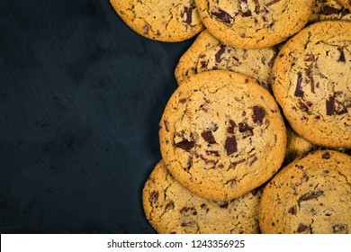 Chocolate Chip Cookies on Black Background. Selective focus.