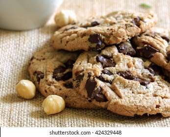 Chocolate chip cookies on brown cloth background