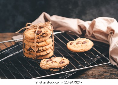 Chocolate chip cookies on grille with black background