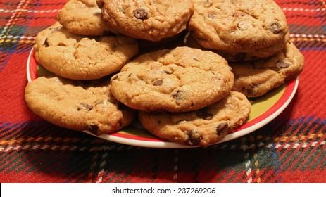 Chocolate chip cookies on Tartan plain background