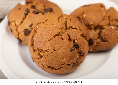 Chocolate chip cookies on white porcelain plate