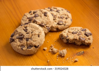 Chocolate chip cookies on wood background.