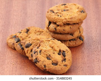 chocolate chip cookies on wooden background