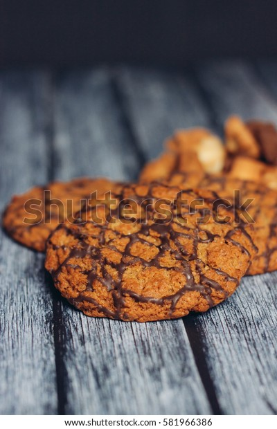 chocolate chip cookies on wooden background.