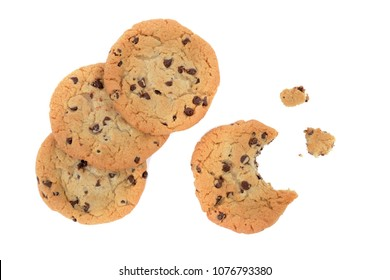 chocolate chip cookies one half eaten on white background