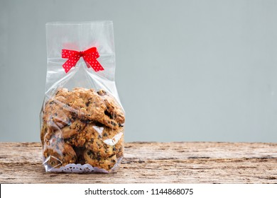 chocolate chip cookies in plastic bag packaging with copy space.