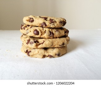Chocolate chip cookies stack, close up, white background. Homemade biscuits, patisserie, confectionery and pastry