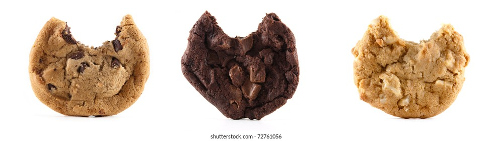 A chocolate chip, double chocolate and macedonia nut cookie with bites out of them on a white isolated background.