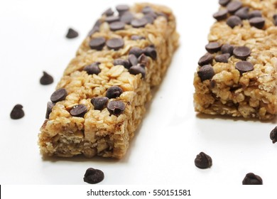 Chocolate chip Granola bars isolated on white, selective focus