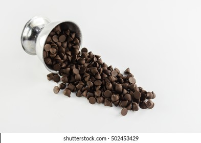 chocolate chip leak from silver cup on white background