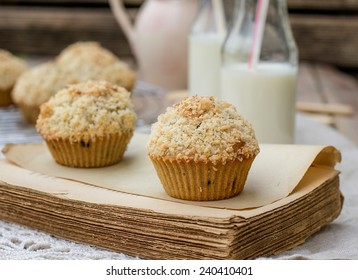 Chocolate chip muffins with coconut streusel on top. Vignetting and rustic style