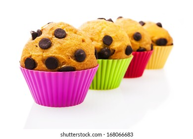 Chocolate chip muffins isolated on white background