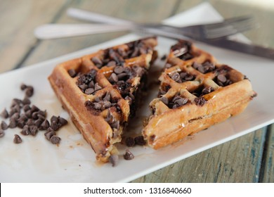 Chocolate chip waffle cut into half