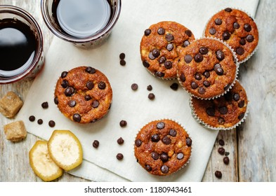 Chocolate chips banana muffins with coffee. toning. selective focus
