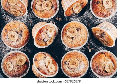chocolate chips banana muffins on rustic background