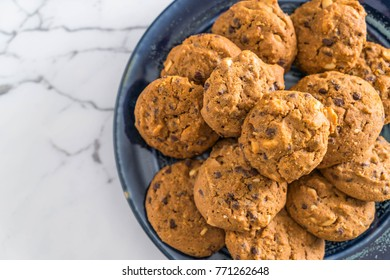 chocolate chips and cashew nut cookies on plate