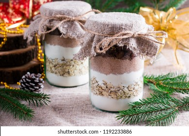 Chocolate chips cookie mix in glass jar over xmas background. Selective focus