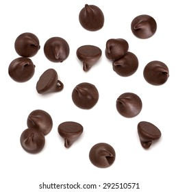 Chocolate chips morsels spread on white background from top