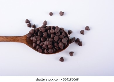 Chocolate Chips on a wooden spoon. Selective Focus.