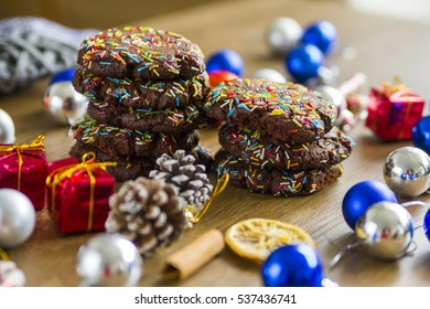 Chocolate Christmas cookies in front of dried orange and fair-tree toys