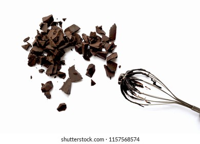 A chocolate chunks with whisk on the white background