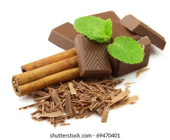 Chocolate, cinnamon with mint on a white background