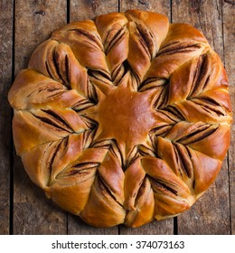 chocolate and cinnamon star braided bread, top view, square image
