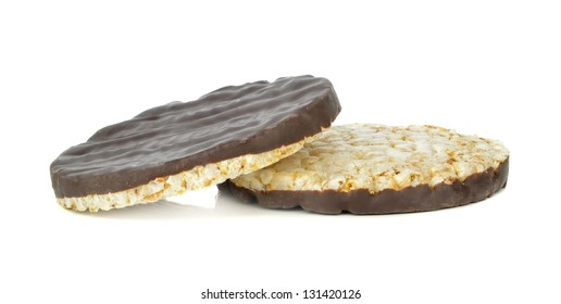 Chocolate coated rice cakes on a white background