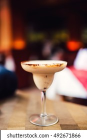 chocolate cocktail drink served with vodka and cocoa garnish at pub