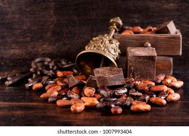 Chocolate and cocoa beans on a wooden background