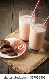 Chocolate and Coconut Cookies and Cream Milkshake in a Glass on Wooden Table. Banana smoothie, iced cocoa and latte.