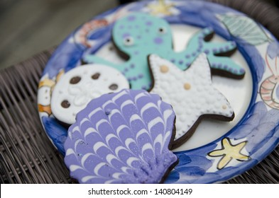 Chocolate coconut cookies decorated with an ocean theme.