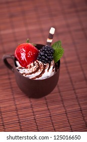 Chocolate coffee cup filled whith mousse