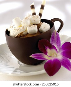 Chocolate coffee cup on white background